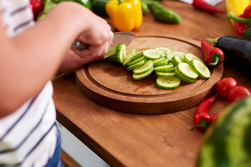 Wooden board and freshness cucumber slices