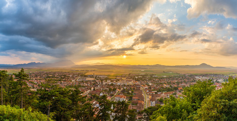 Wall Mural - Landscape with aerial view of Rasnov town at sunset, Brasov, Transylvania, Romania