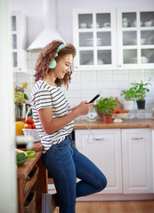 Side view of woman with telephone and headphones
