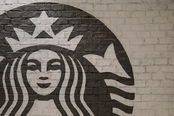 Bangkok, Thailand - August 11, 2018 : Starbucks coffee logo on the wall in front of the shop.