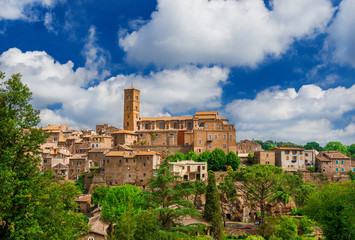 View of the ancient medieval historic center of Sutri among woods and clouds, a small and characteristic ancient town near Rome, along the famous pilgrim route knows as 'Via Francigena'