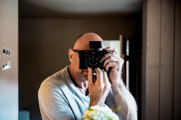 young man with a leica camera