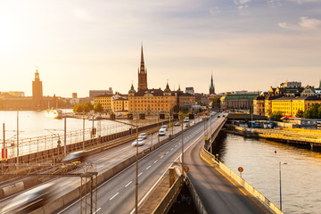 Scenic view of old buildings and car traffic at the bridge Stockholm, Sweden.