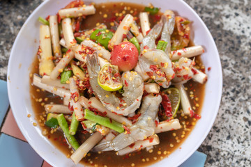 Papaya salad or what we called in Thai Som Tum with lotus stem is the popular Thai style local the eastern delicious famous food of Thailand