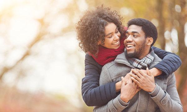Serene couple in love walking in autumn park