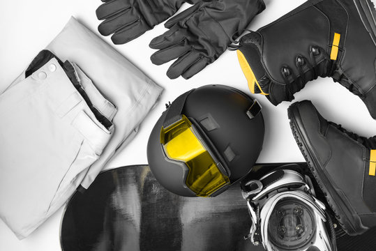 Set of protective accessories and clothing for snowboarding, mask glasses,helmet, pants, shoes, gloves, snowboard
