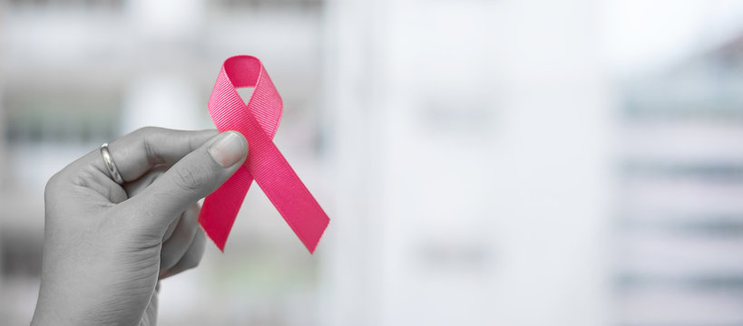October Breast Cancer Awareness month, Woman holding Pink Ribbon for supporting people living and illness. Healthcare, International women day and World cancer day concept