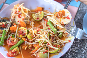 Papaya salad or what we called in Thai Som Tum the popular Thai style local the eastern delicious food of Thailand