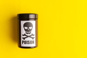 Concept of poison, toxic substances, drug overdose, lethal dose,glass jar with skull and crossbonesl
