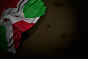 cute labor day flag 3d illustration. - dark picture of Burundi flag with big folds on dark wood with free place for your content