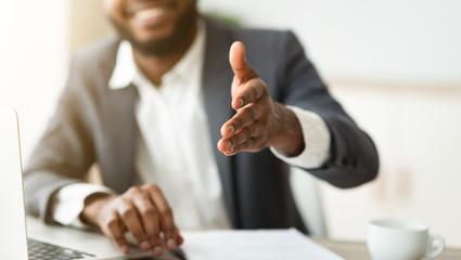 Fototapete - Black businessman gives hand for handshake proposes partnership