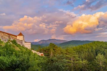Wall Mural - Landscape with Medieval fortress Rasnov at sunset, Brasov region, Transylvania, Romania