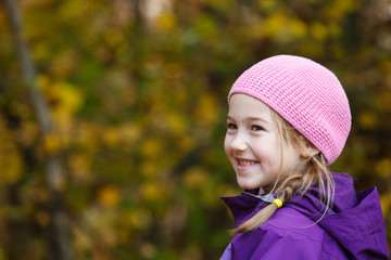 Girl with plait in winter cap