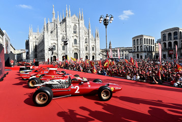 Italian premium sports car maker Ferrari celebrates 90 years of its racing team at Milan's Duomo square