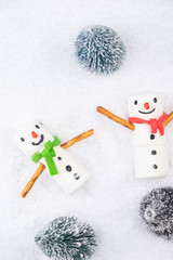 Marshmallow Funny Snowman Play in Snow. Festive Christmas Creative Concept Card.