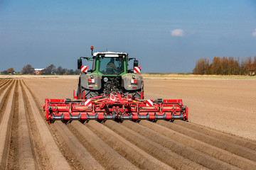 Tractor on the field at the potato cultivation