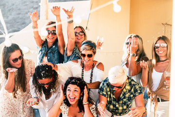 Group of people women friends have fun together celebrating with confetti and happiness - concept of friendship and event celebration Wall mural