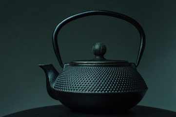 Black textured cast iron kettle