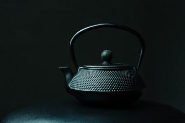 Black textured cast iron kettle
