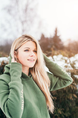 Young attractive scandinavian girl during winter hiking in the mountains