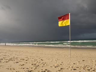 Life saving flag on beach