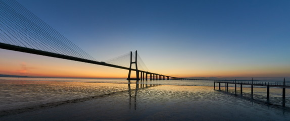 Staande foto Bruggen Long exposure shot of Vasco da Gama bridge in Lisbon