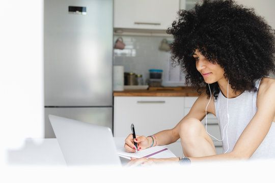 Young woman using her laptop at home