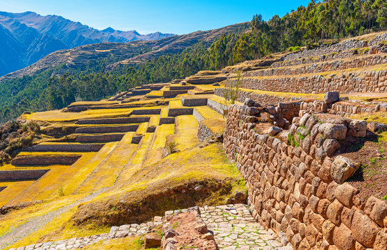 The Inca ruin of Chinchero with its terraces used for agriculture fields in the Sacred Valley of the Inca near Cusco, Peru.
