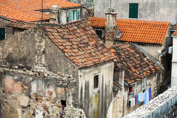 Wall Mural -  cityscape with ancient buildings and tiled roofs