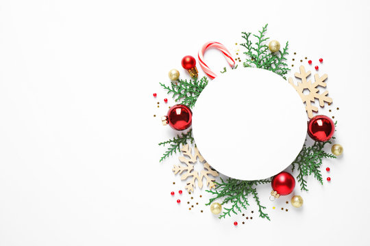 Flat lay composition with Christmas decor and blank card on white background. Space for text