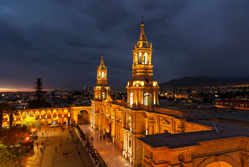 Fotomurales - Cityscape of Arequipa after sunset with the illuminated Cathedral and the Plaza de Armas main square, Peru.