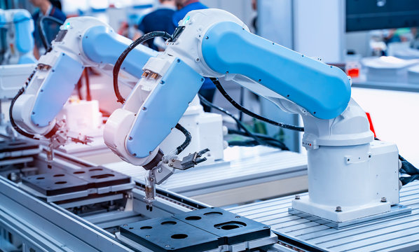 robotic arm catch for electronic assembly line. The robot for smart technology manufacturing process.