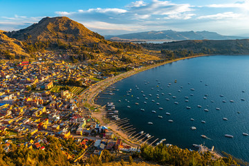 Cityscape of Copacabana city and the Titicaca Lake at sunset, Bolivia.