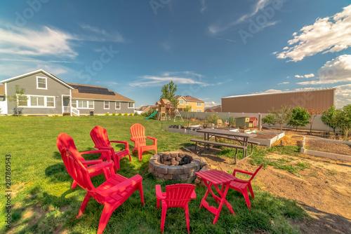 Terrific Backyard Chairs Around A Stone Fire Pit Adjacent To A Picnic Machost Co Dining Chair Design Ideas Machostcouk
