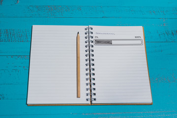 notebook with Brainstorming title on page and progress bar loading