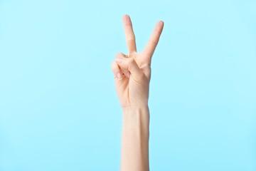 Fototapeta human hand showing number two obraz