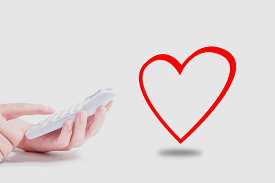 Calculator and heart symbol. Reliable price, Clear accounting, etc.  電卓とハートマーク 安心価格、明朗会計などのイメージ