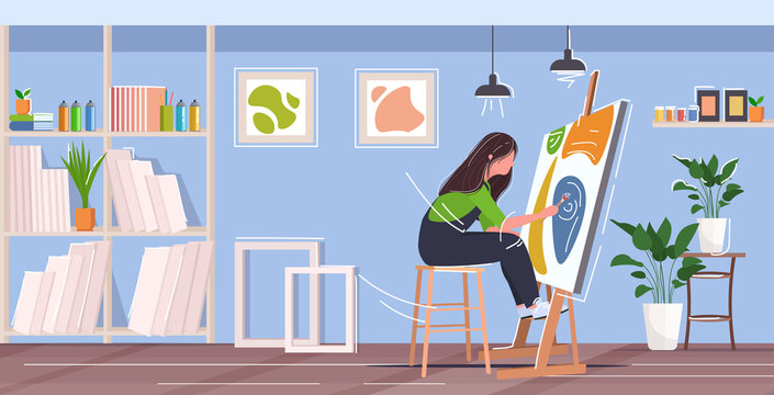 painter using paintbrush and palette woman artist sitting in front of easel art creativity hobby creative occupation concept modern workshop studio interior full length horizontal
