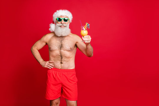 Portrait of his he nice attractive cheerful cheery funky gray-haired man having fun poolside drinking fresh tasty juice rest relax toast cheers isolated over bright vivid shine red background