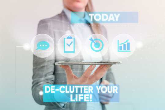 Writing note showing De Clutter Your Life. Business concept for remove unnecessary items from untidy or overcrowded places Female human wear formal work suit presenting smart device