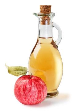 Fresh ripe apples and apple cider vinegar. White background.