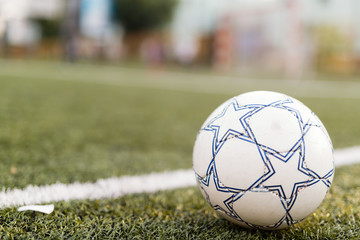 Picture of soccer ball on court by line