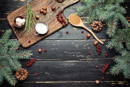 Ingredients for Christmas pie on dark wooden background