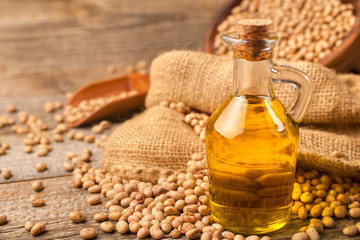 Homemade organically produced soybean oil on a rustic wooden table