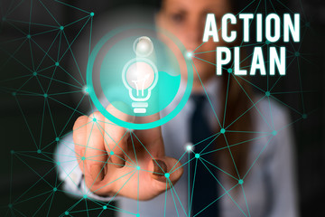Word writing text Action Plan. Business photo showcasing detailed plan outlining actions needed to reach goals or vision Female human wear formal work suit presenting presentation use smart device