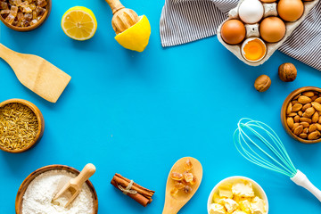 Baking frame. Ingredients and utensil on blue background top view space for text