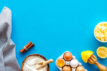 Baking ingredients on blue background top view space for text