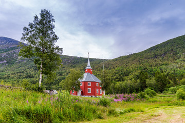 Beautiful red wooden little church of Lonset, Oppdal municipality in Trondelag county in Norway, Scandinavia