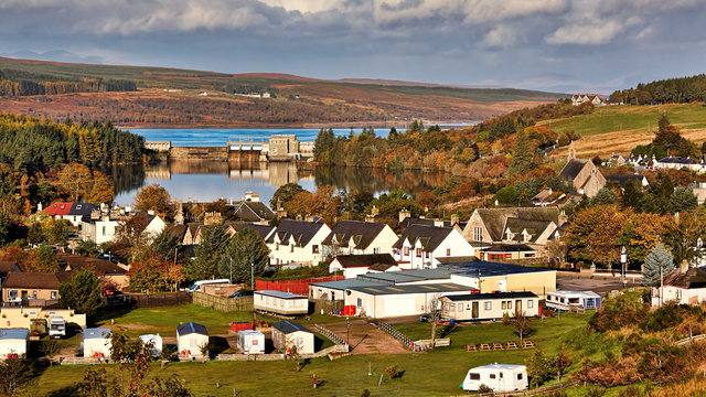 View over the village of Lairg in the Highlands of Scotland to Lairg dam and Loch Shin