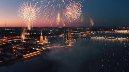 Fotobehang - Fireworks display over river and night city skyline. Saint Petersburg, Russia. 4K UHD.